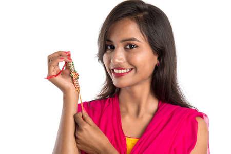 Photo pour Beautiful Indian girl showing Rakhis on occasion of Raksha bandhan. Sister tie Rakhi as symbol of intense love for her brother. - image libre de droit