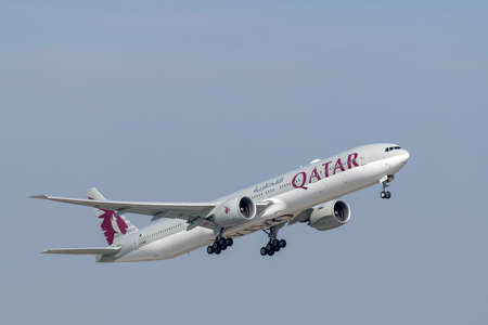 Munich, Germany - April 17. 2019: Qatar Airways Boeing 777-3DZ with the aircraft registration A7-BEK is starting on the southern runway 8R of the Munich airport MUC EDDM