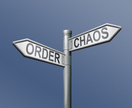chaos order road sign on blue background