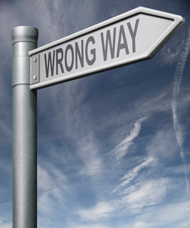 wrong way sign road sign arrow pointing towards incorrect direction make mistake error bad choice