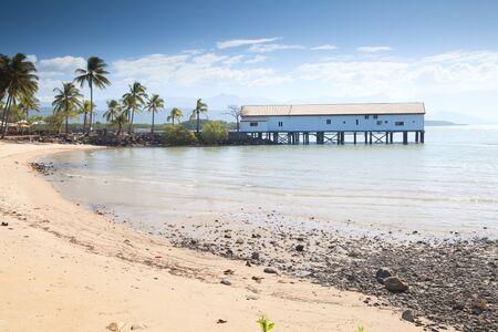 port douglas tropical queensland australia boat house with palm trees sand on beach pole house