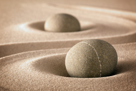 Photo for purity and spirituality in the harmony of a zen garden stones and lines in sand for concentration and relaxation pure nature or spa wellness background - Royalty Free Image