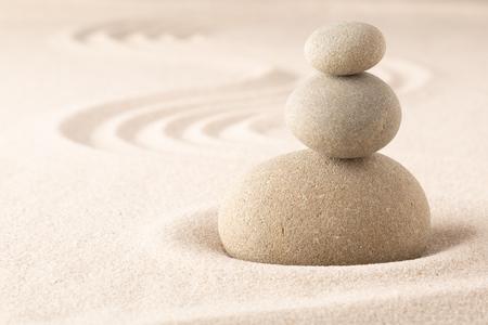 Foto de Yoga or spa wellness sandy background with round zen stone in Japanese sand garden and open copy space. Pile of stones balancing. - Imagen libre de derechos