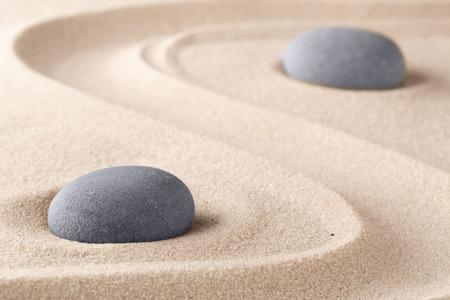 Foto de Zen garden meditation stone. Round rock on sandy texture background. Yoga or mindfulness concept. - Imagen libre de derechos