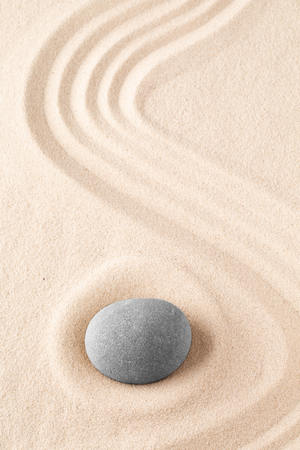 Photo for Zen garden meditation stone. Round rock on sandy texture background. Yoga or mindfulness concept. - Royalty Free Image