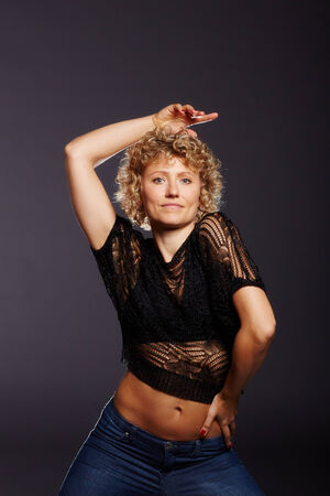 Blonde curly woman at dancing