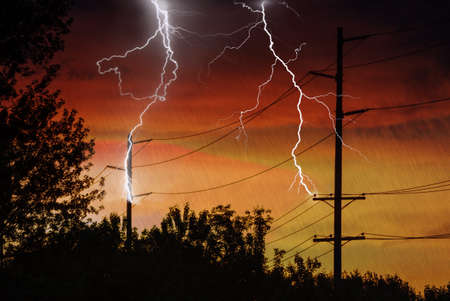 Silhouette of Power Lines being struck by lightning.