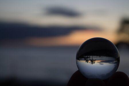 Photo pour Nice landscape behind a crystal ball - image libre de droit