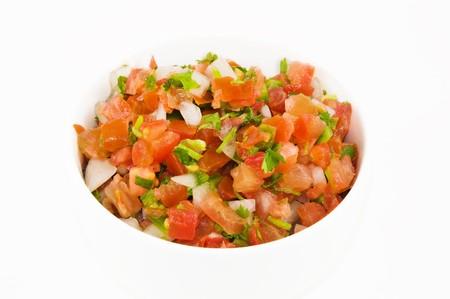 A dish of pico de gallo, isolated on white