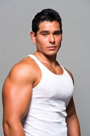 Athletic young man in a white undershirt