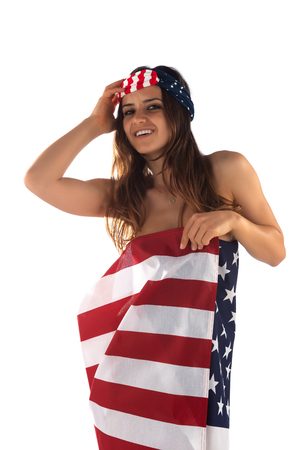 Photo pour Dark skinned Romanian brunette wrapped in an American flag - image libre de droit