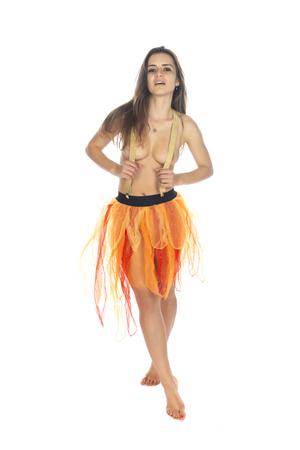 Photo pour Beautiful slender Romanian brunette topless in an orange tulle skirt - image libre de droit