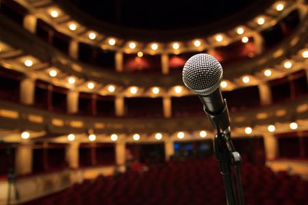 Photo pour Close up of microphone in concert hall, theater - image libre de droit