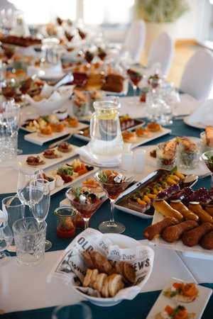 Photo pour Food served on table in a white hall during a Birthday party in Eastern European Baltic Riga Latvia - Blue and teal colors - Canape, snacks and light drinks - image libre de droit