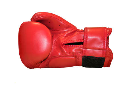 A studio shot of a red boxing glove isolated