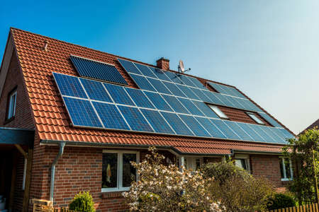 Photo for Solar panel on a red roof - Royalty Free Image