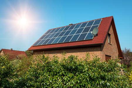 Photo pour Solar panel on a red roof  - image libre de droit