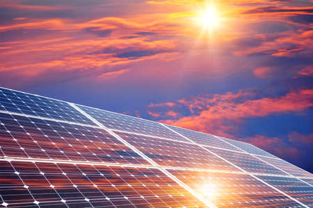 Photo pour Photo collage of sunset and solar panel, photovoltaic, alternative electricity source - concept of sustainable resources - image libre de droit