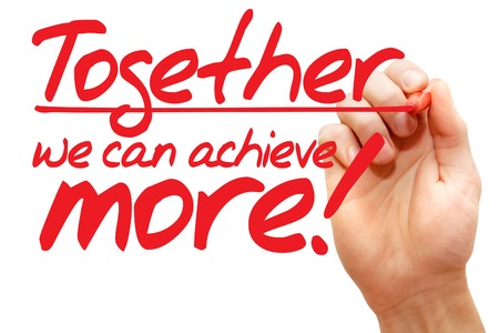 Foto de Hand writing Together we can achieve more with red marker, business concept - Imagen libre de derechos