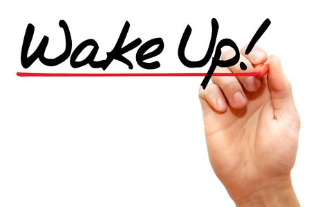 Hand writing Wake Up! with marker, business concept