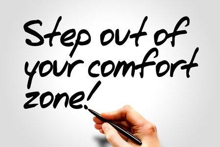 Hand writing Step out of your comfort zone!, business concept