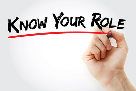 Hand writing Know your Role with marker, business concept background
