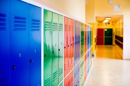 Foto de Colorful metal lockers installed in the hallway of the school. - Imagen libre de derechos