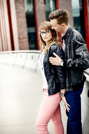 3b75578e2 Young couple in love hugging outdoors. Engagement session. Dressed ...