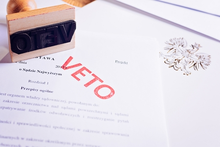 Polish law act with red veto stamp. President veto