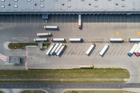 Photo for Aerial drone view on warehouse and logistic center. Logistic and transport concept - Royalty Free Image