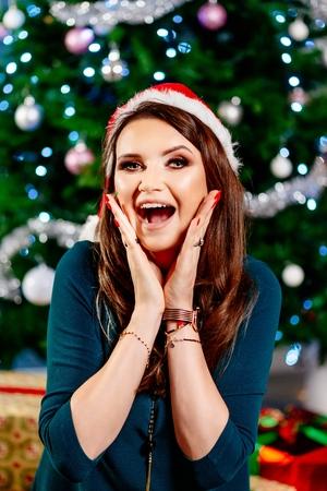 Surprised happy woman at Christmas. Woman at Christmas. Christmas surprise.