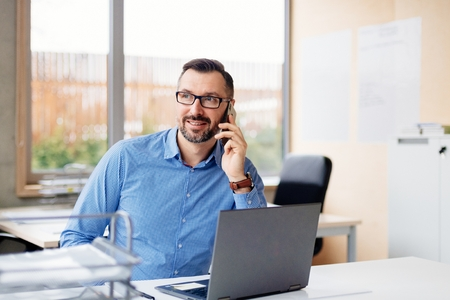 Photo for 40 years old middle aged handsome man working on laptop computer in office. Man working in office - Royalty Free Image