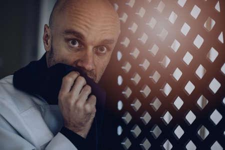 Photo pour Priest vicar in confession booth. - image libre de droit