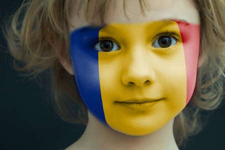 Photo pour Portrait of a child with a painted Romanian flag - image libre de droit