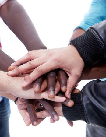 Photo pour Many multiracial hands coming together as a team! - image libre de droit