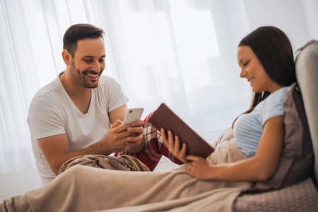 Photo for Young happy couple in bed in the morning. - Royalty Free Image