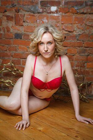 Foto de Young beautiful model posing in red underwear - Imagen libre de derechos