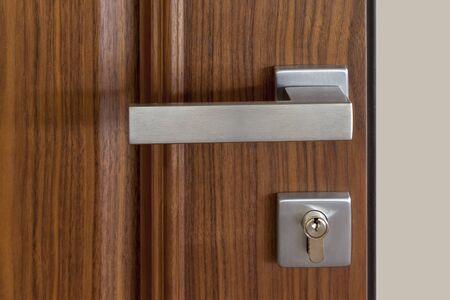 Photo for metal door handle and lock on wooden door, close up - Royalty Free Image