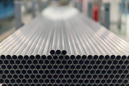 Photo pour steel pipes on the pile, close up - image libre de droit