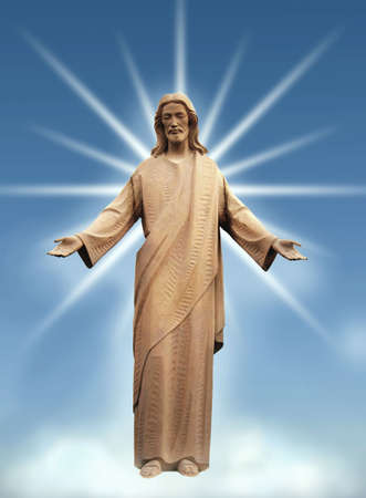 Jesus standing on a cloud - beams of light from behind.