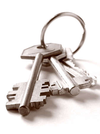 sepia toned bunch of keys on white