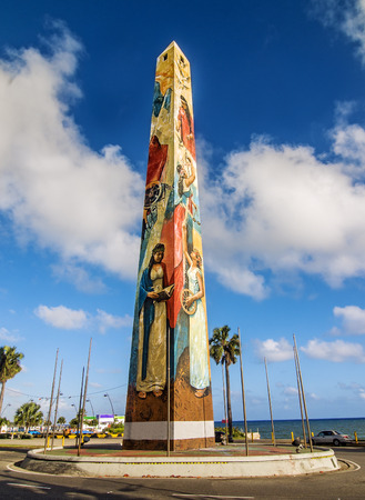 STO DOMINGO, DOMINICAN REPUBLIC - FEBRUARY 13  The obelisk by the sea at Santo Domingo Malecon stands as one of  the city most recognized monuments  on Feb 13, 2014 in Sto Domingo, Dominican Republic