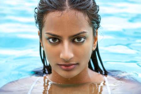 Photo for Portrait of beautiful sexy young Indian Asian woman or girl wearing bikini in swimming pool - Royalty Free Image