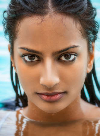 Photo pour Portrait of beautiful sexy young Indian Asian woman or girl wearing bikini in swimming pool - image libre de droit
