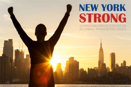 Photo pour Silhouette of a successful woman or girl arms raised celebrating at sunrise or sunset in front of the New York City Skyline with New York Strong Coronavirus COVID-19 Global Pandemic 2020 text - image libre de droit