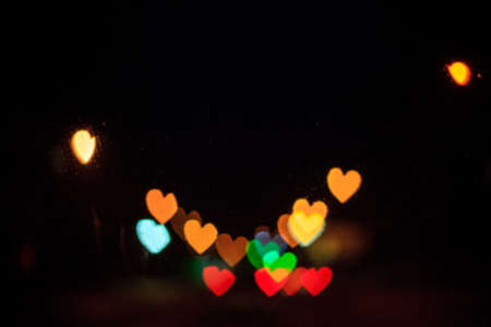 Photo for Blur background with glowing heart bokeh. Defocus abstract romantic shiny wallpaper. Valentine day blurry urban street lights - Royalty Free Image