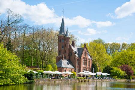 Foto für Bruges, Belgium - April 17, 2017: Minnewater castle at the Lake of Love in Bruges, Belgium - Lizenzfreies Bild