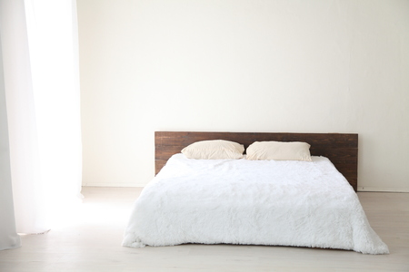 Interior white bedroom this morning with bed