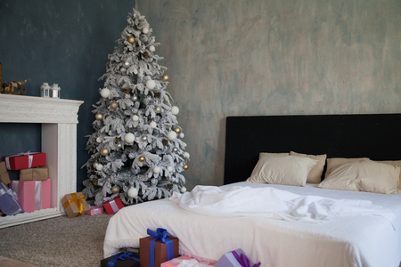 Photo for Christmas Decor bedroom bed gifts new year Christmas tree - Royalty Free Image