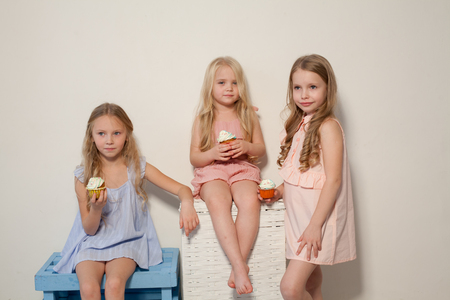 Foto de eat sweet candy lollipop three little girls blonde - Imagen libre de derechos
